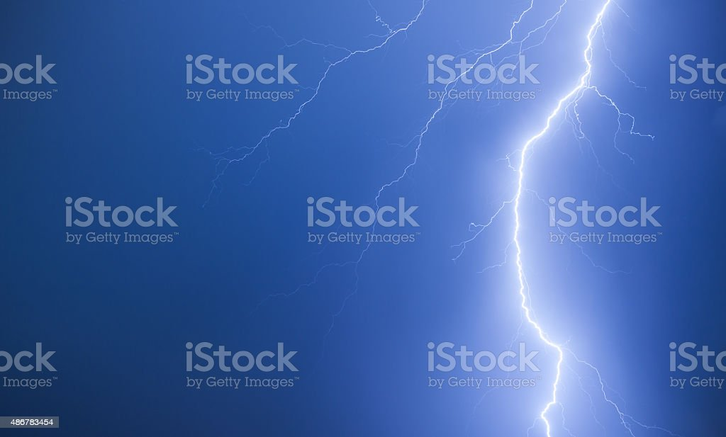 Bright lightning on a dark blue night sky stock photo