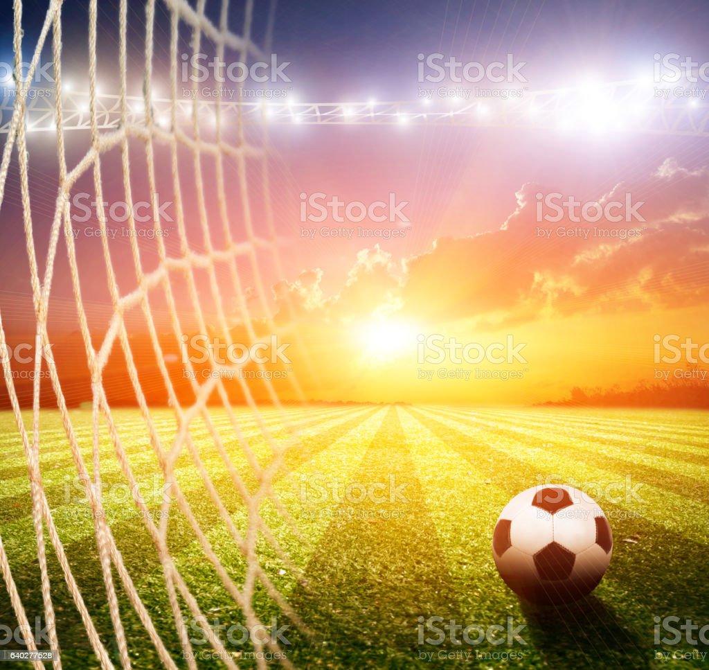 Bright lights at night and soccer stadium stock photo