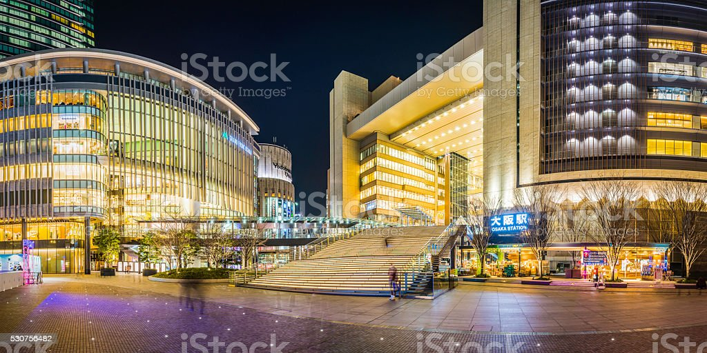 Bright lights shopping malls city plaza nightlife Osaka panorama Japan stock photo