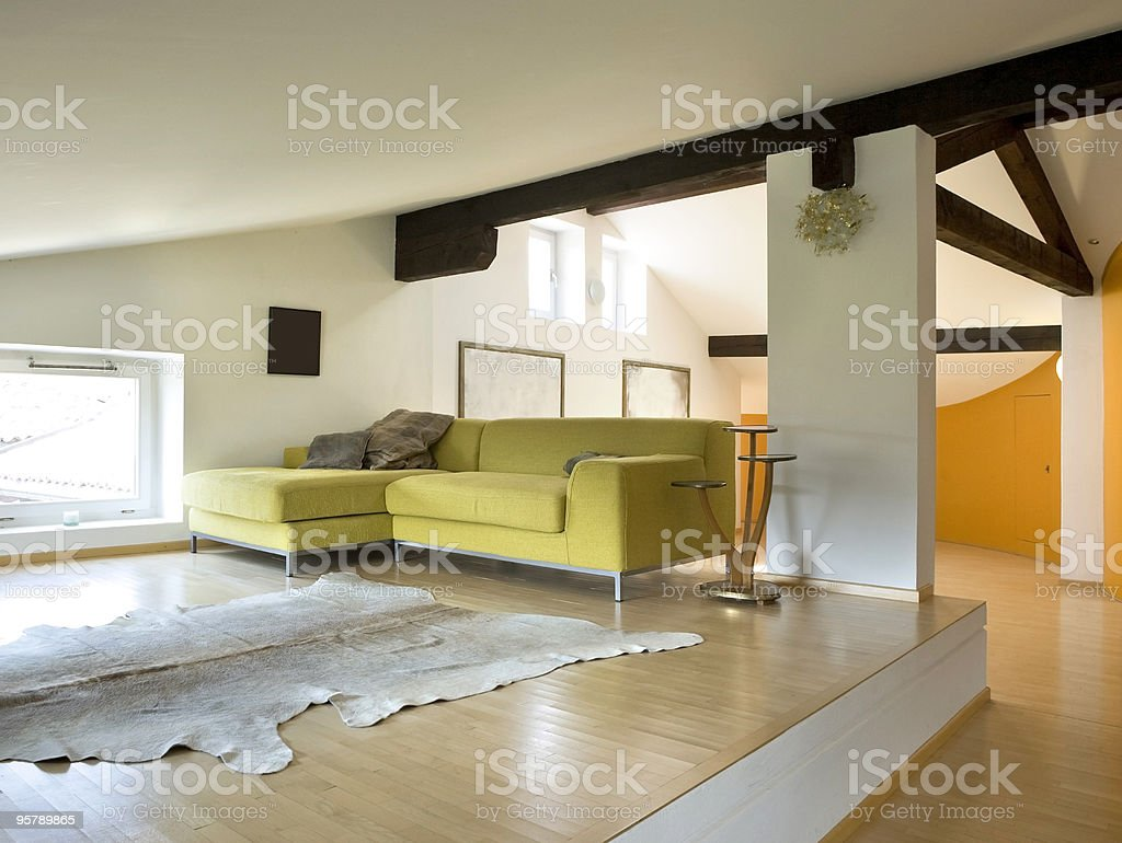 Bright loft-style apartment with wood floors royalty-free stock photo