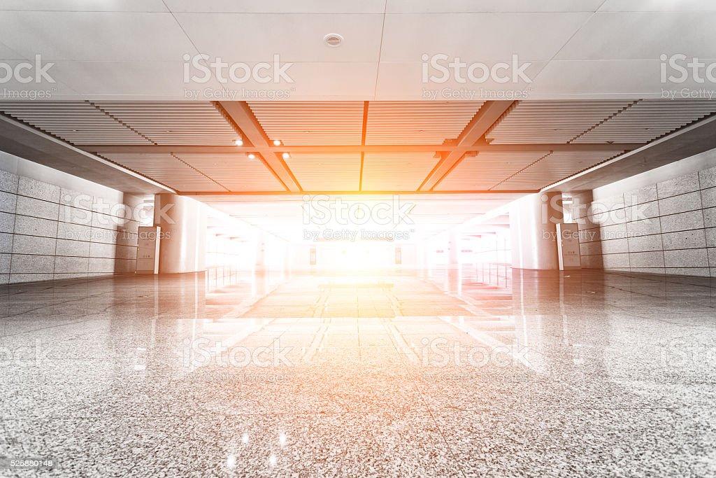 Bright long corridor in airport stock photo