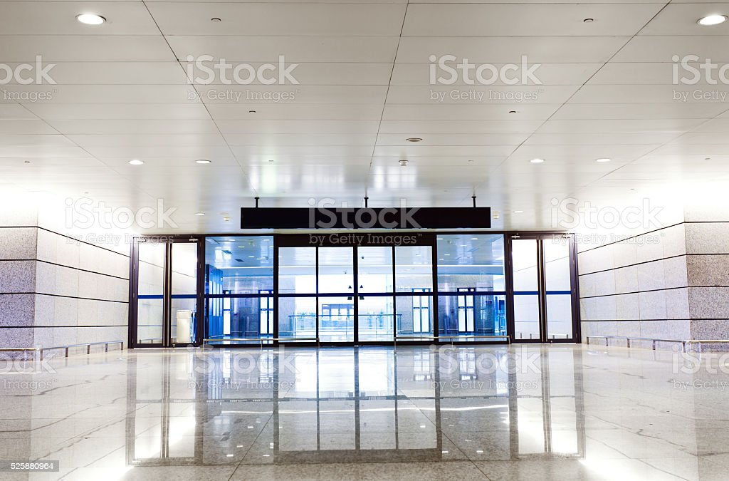 Bright long corridor in airport stock photo