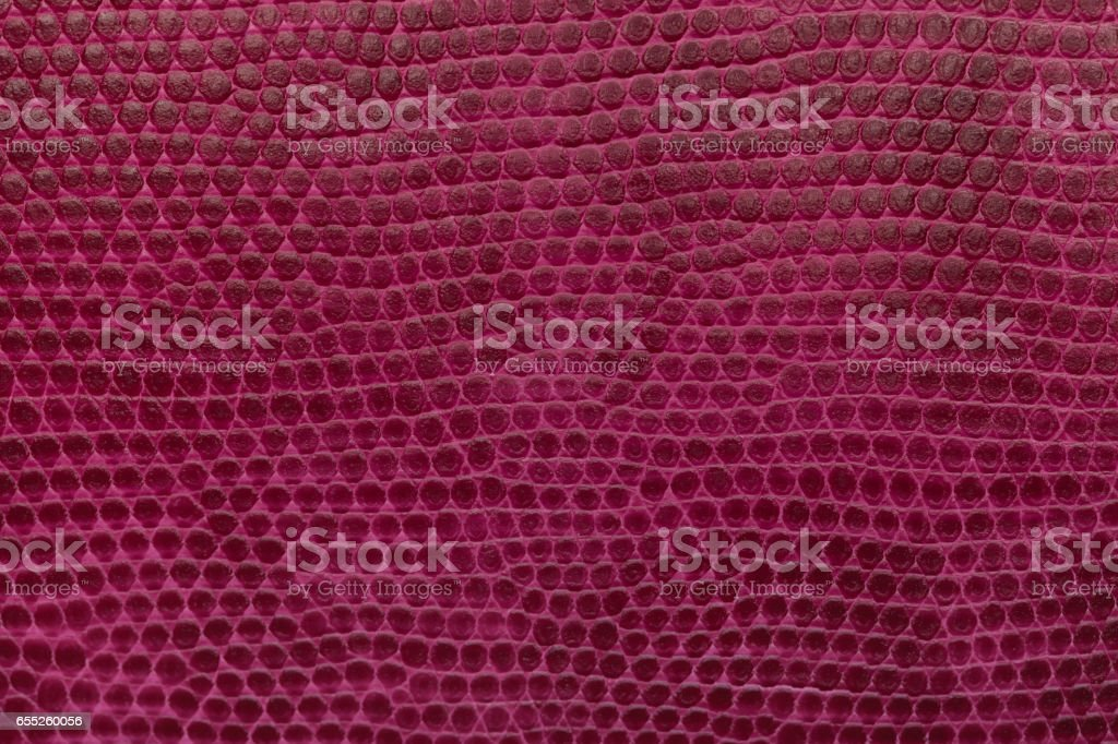 Bright magenta leather texture background. Closeup photo. stock photo