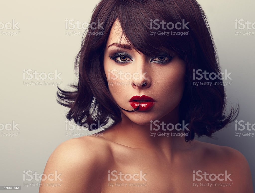 Bright makeup beautiful woman with short black hair style stock photo