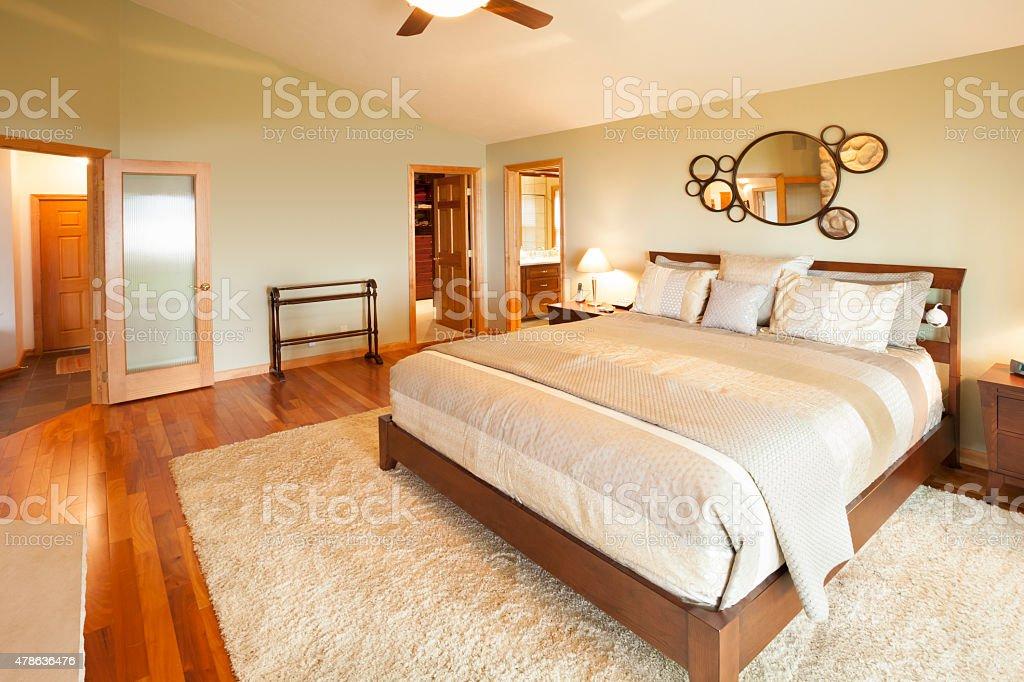 Bright Master Bedroom with Hardwood Floor stock photo