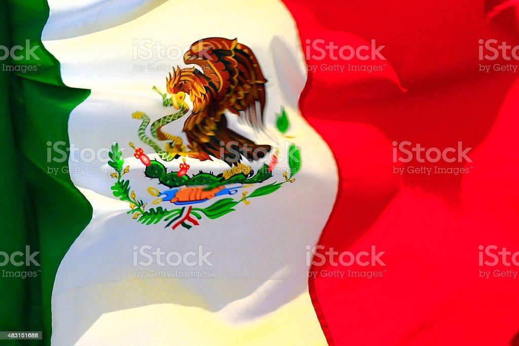 Bright Mexican flag in sunny Cancun, Mexico Caribbrean stock photo
