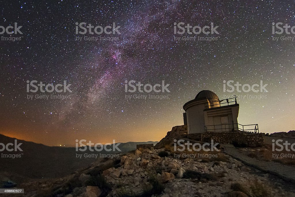 Bright Milky Way sky with Observatory in the distance royalty-free stock photo