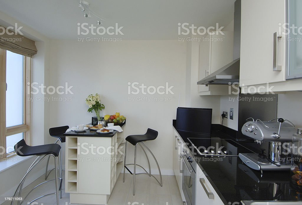 Bright Modern Apartment Kitchen with Window royalty-free stock photo
