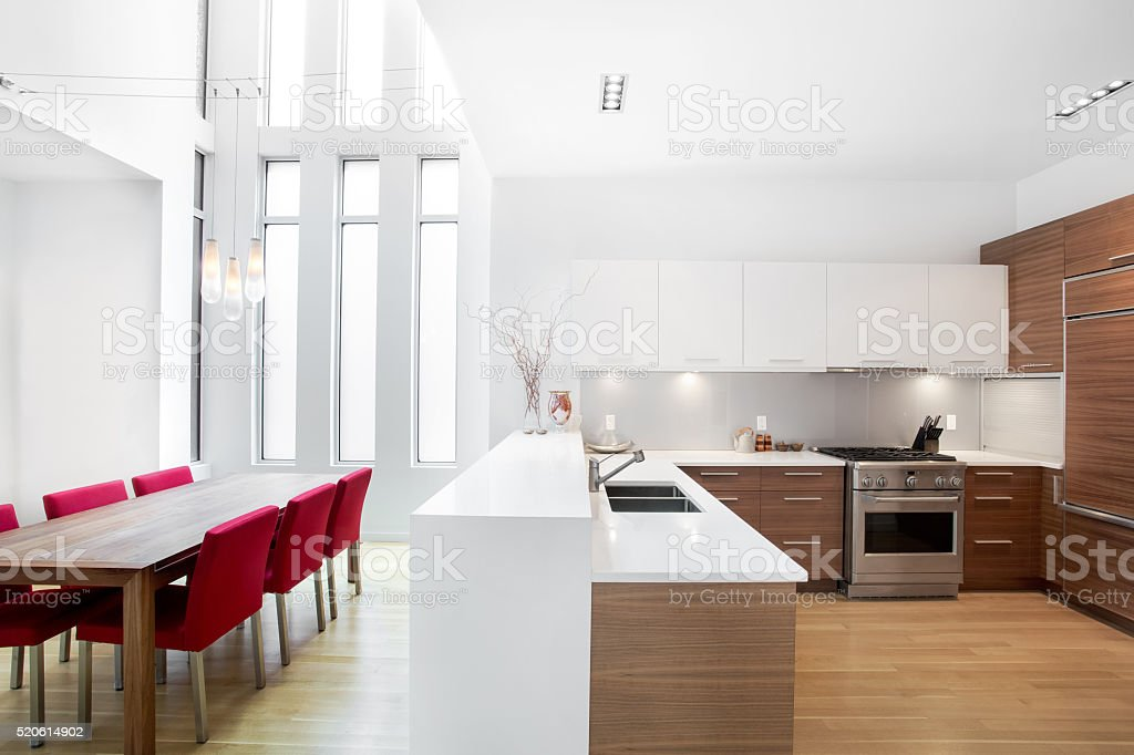 Bright modern contemporary kitchen and dinning room stock photo