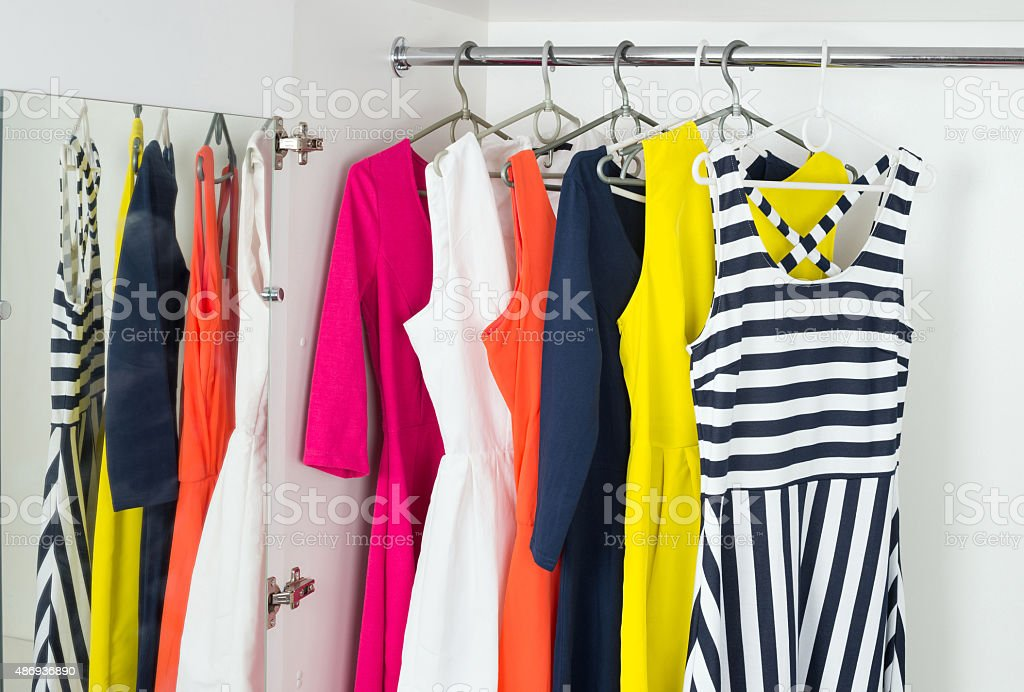 bright modern fashion women's dresses stock photo
