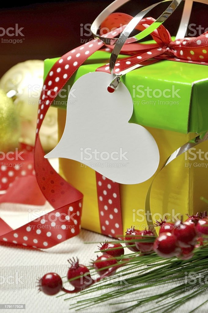 Bright Modern Red, Green and Yellow Christmas Present Closeup royalty-free stock photo