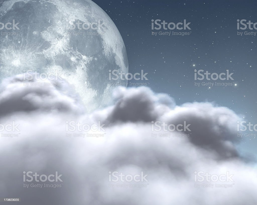 Bright moon over clouds stock photo