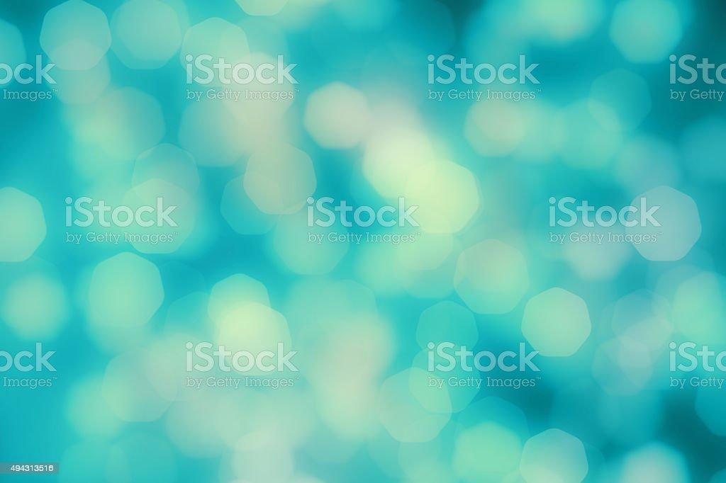 Bright multicolor blurred bokeh dots on dark background stock photo