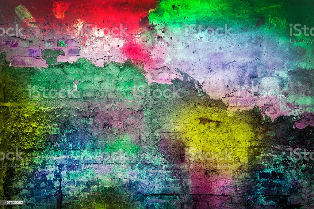 Bright multicolored smudges of paint on an old wall stock photo