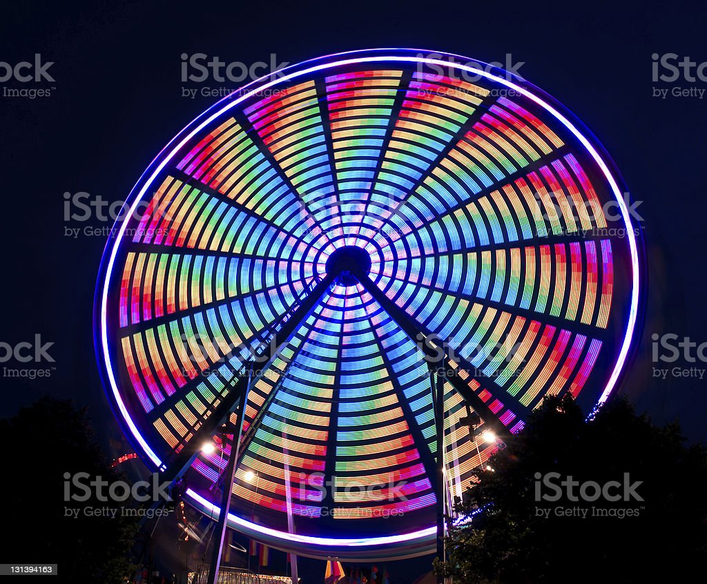 Bright Multi-Colored Spinning Ferris Wheel royalty-free stock photo