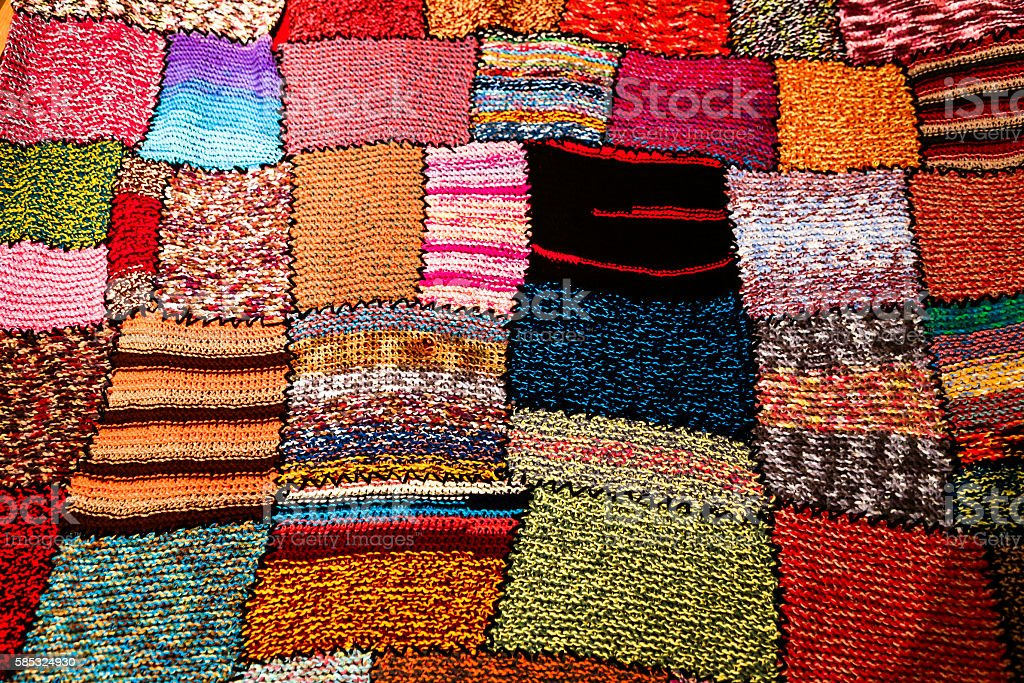 Bright multi-coloured handmade patchwork blanket stock photo