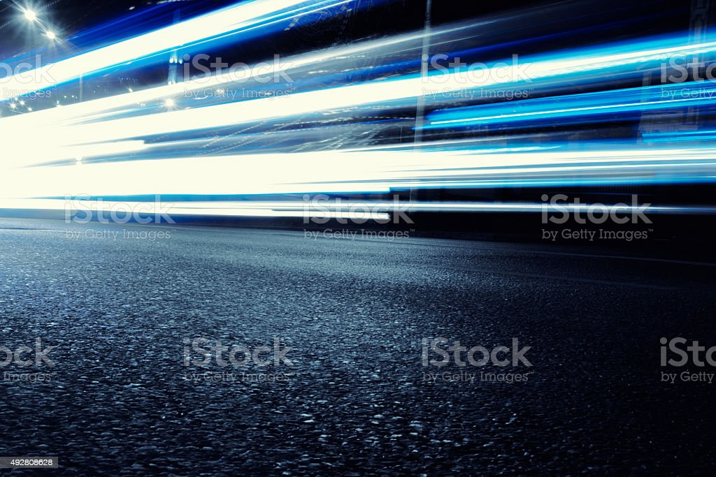 Bright Neon Blue Car Light Trails stock photo