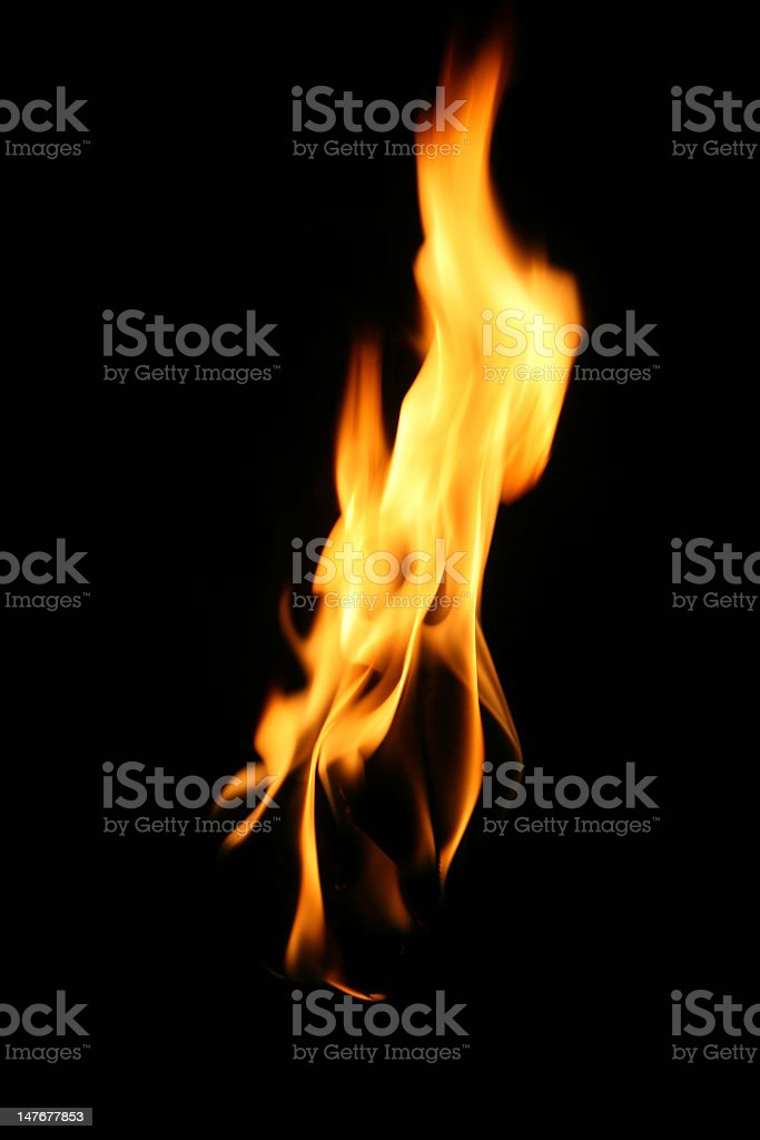 Bright orange flame of a fire on black background stock photo