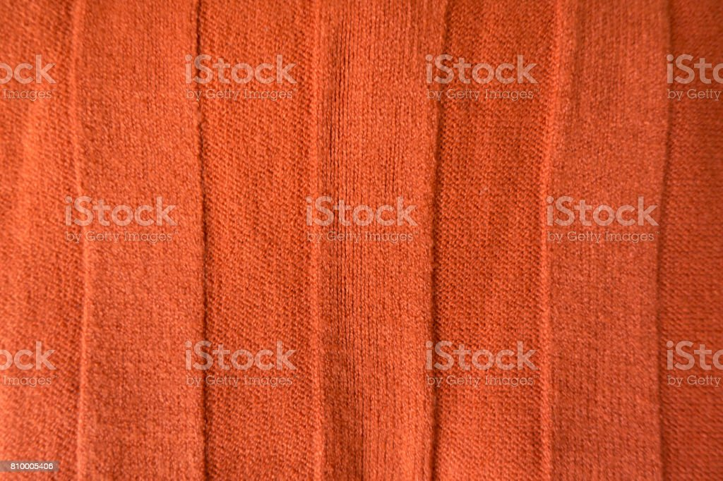 Bright orange stockinet fabric with wide relief stripes from above stock photo