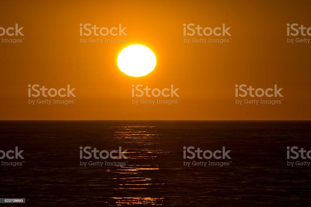 Bright Orange Sun over Ocean stock photo