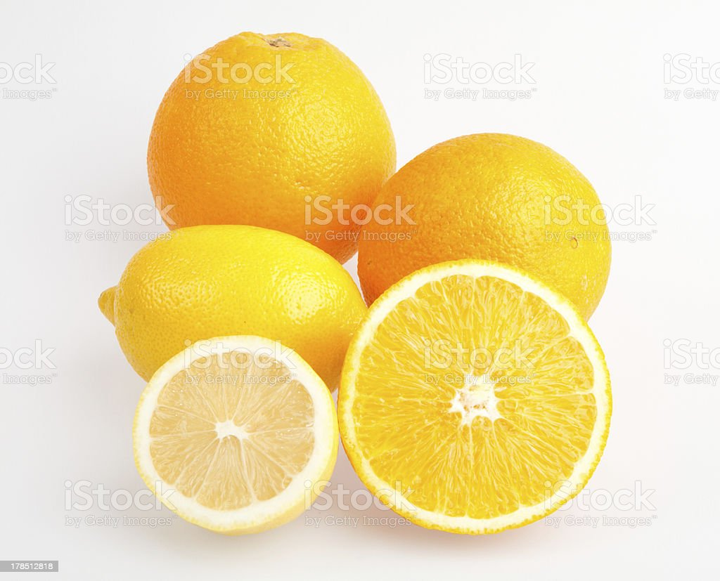 Bright orange with half a lemon isolated royalty-free stock photo
