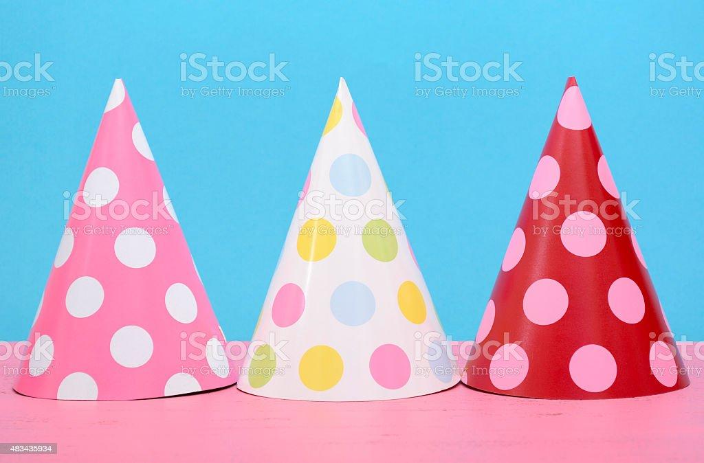 Bright party polka dot party hats stock photo