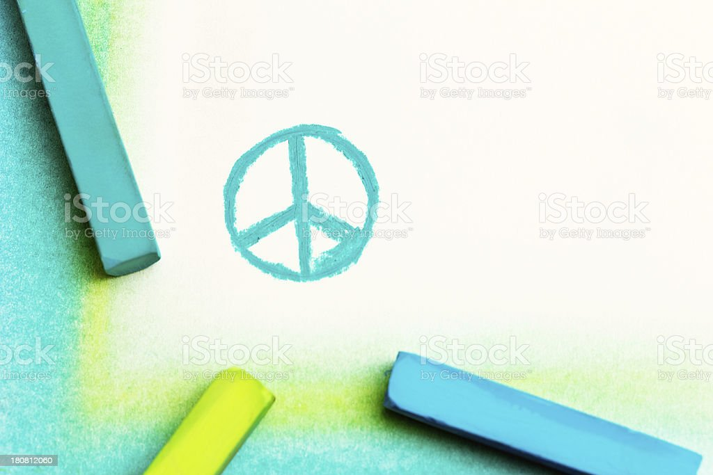 Bright pastel crayons draw the CND or Peace symbol stock photo