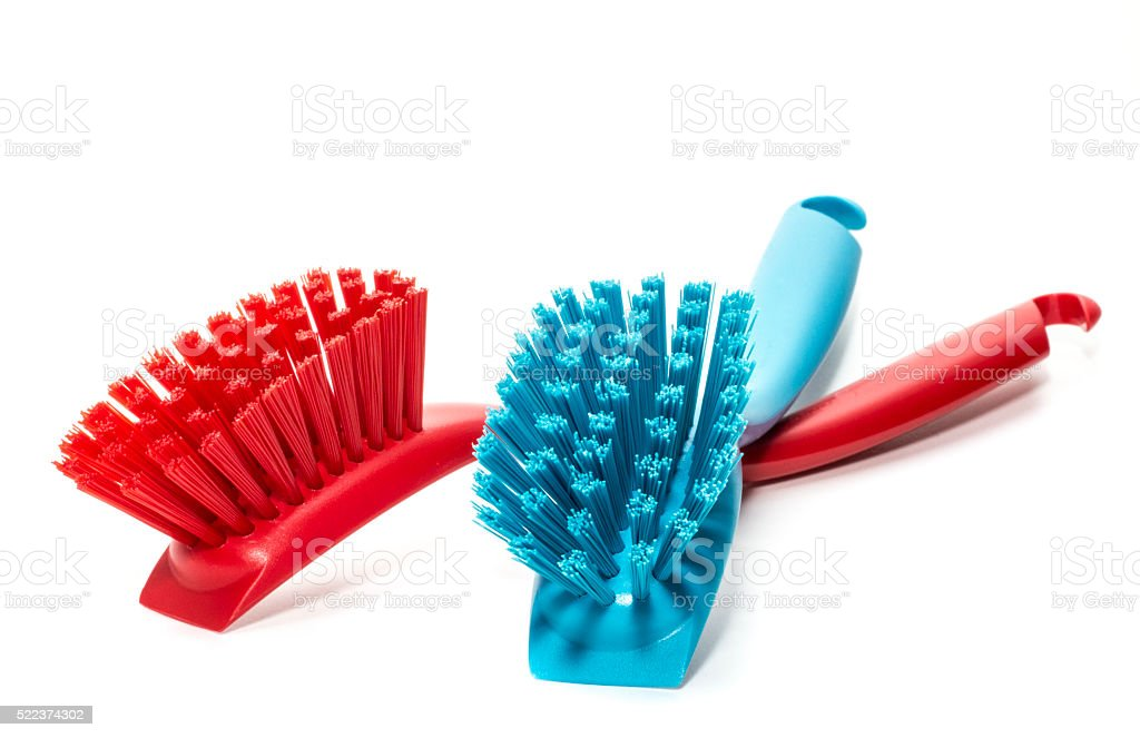 bright plastic brush isolated on a white background stock photo