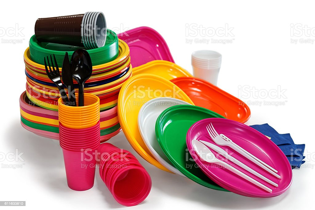 Bright Plastic tableware isolated on the white stock photo