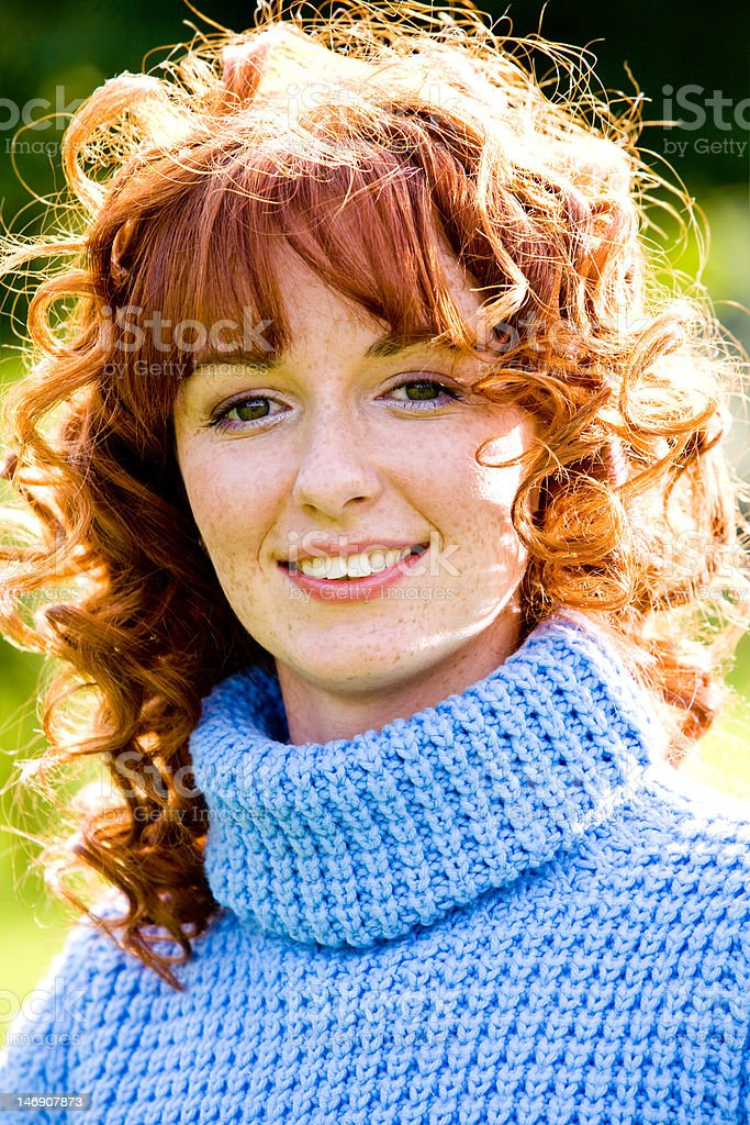 Bright portrait of red-haired young woman outdoors royalty-free stock photo