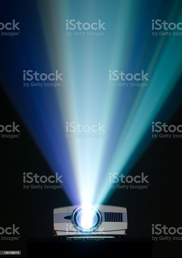 A bright projector shining bright stock photo