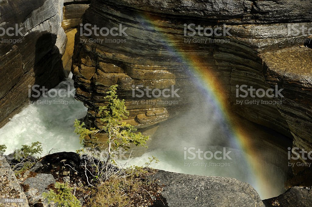 Bright rainbow above mountain river in Mistaya Canyon, Canada stock photo