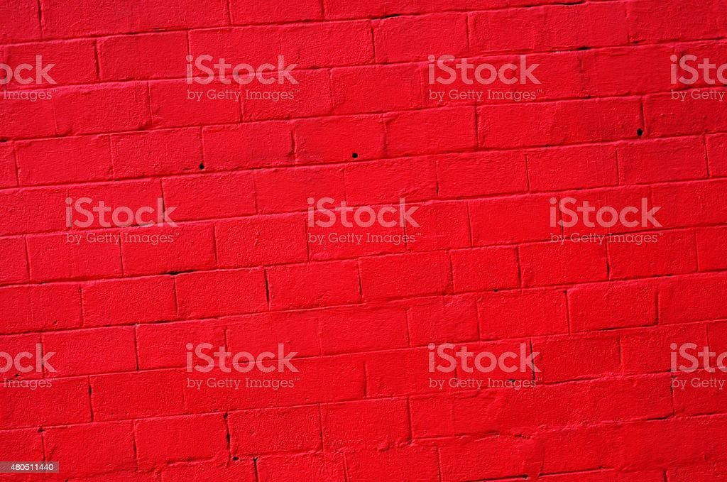 bright red concrete wall background stock photo