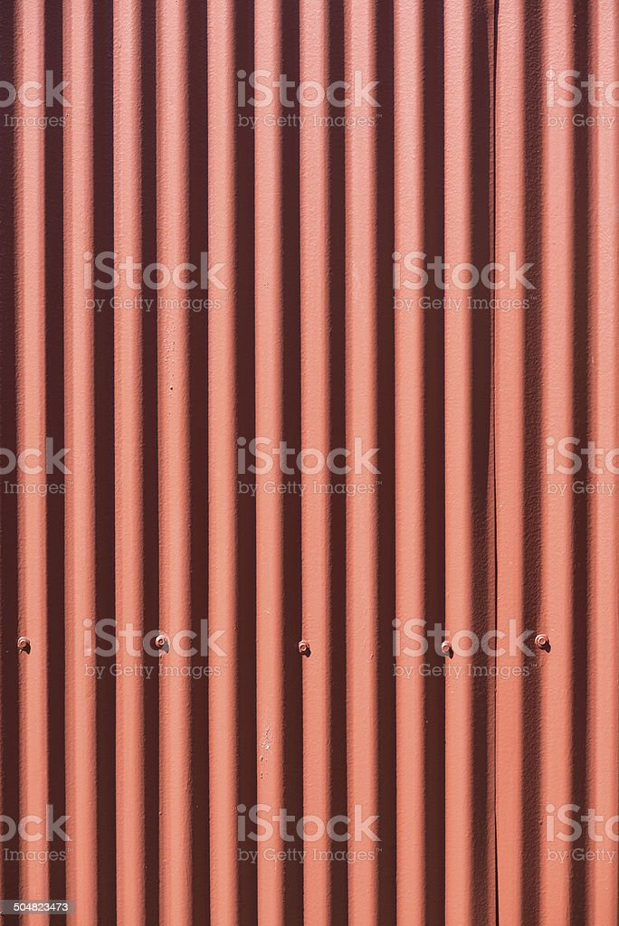 Bright Red Corrugated Metal Wall royalty-free stock photo