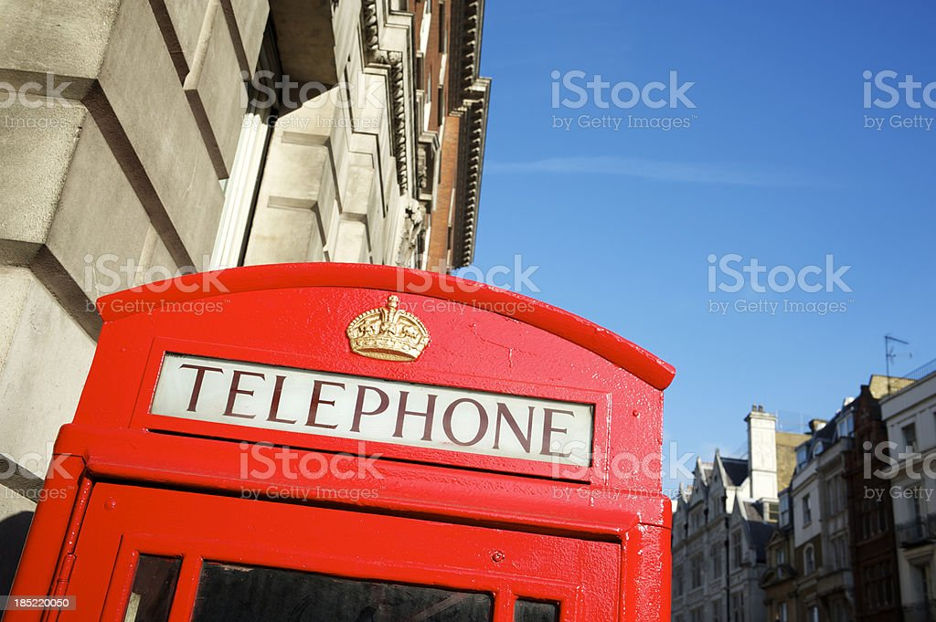 Bright Red English Telephone Booth London Street royalty-free stock photo