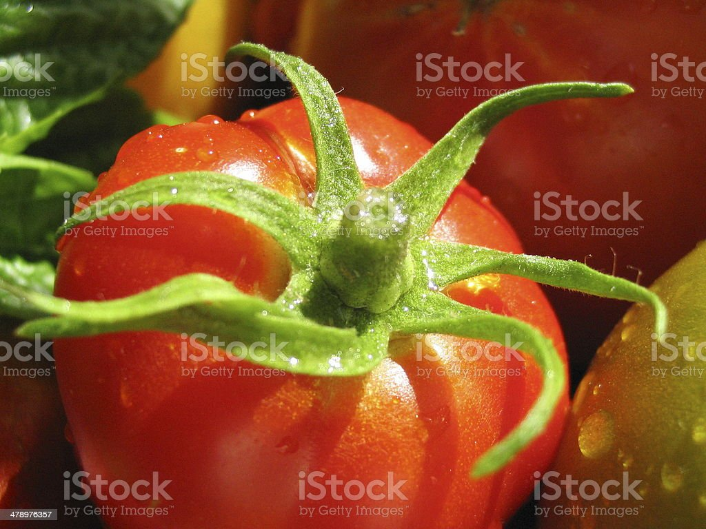 Bright Red Heirloom Tomato Background royalty-free stock photo