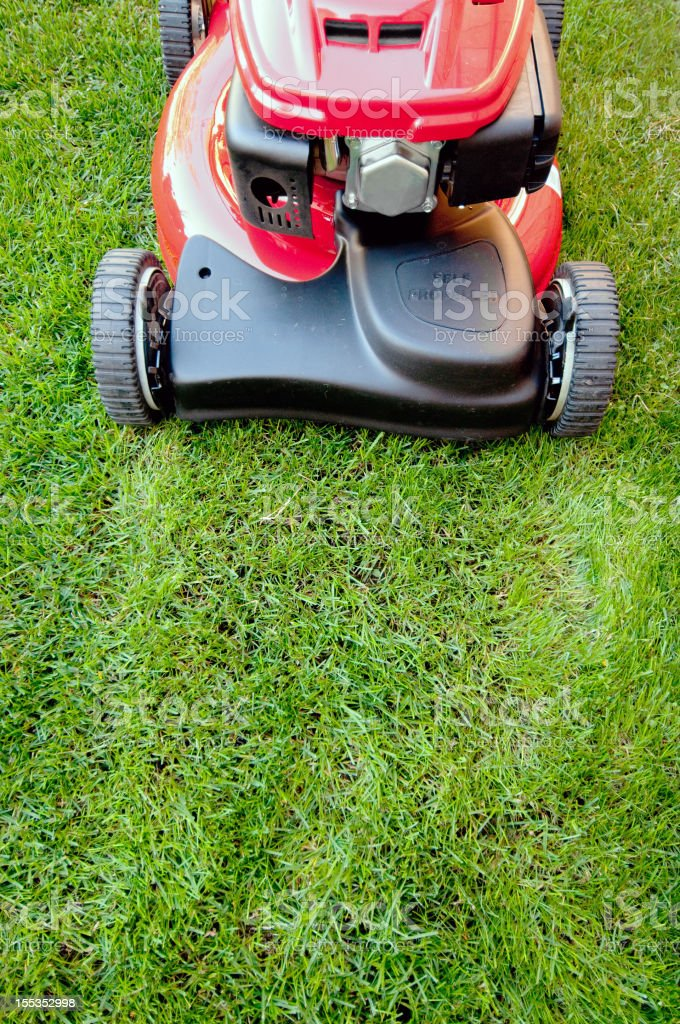 Bright red lawn mower ready for business royalty-free stock photo