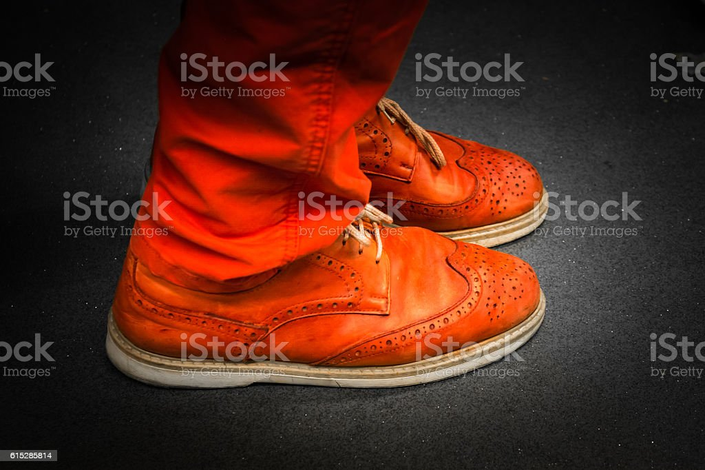 Bright Red Leather Footwear Unique Matching Pants Color Isolated stock photo