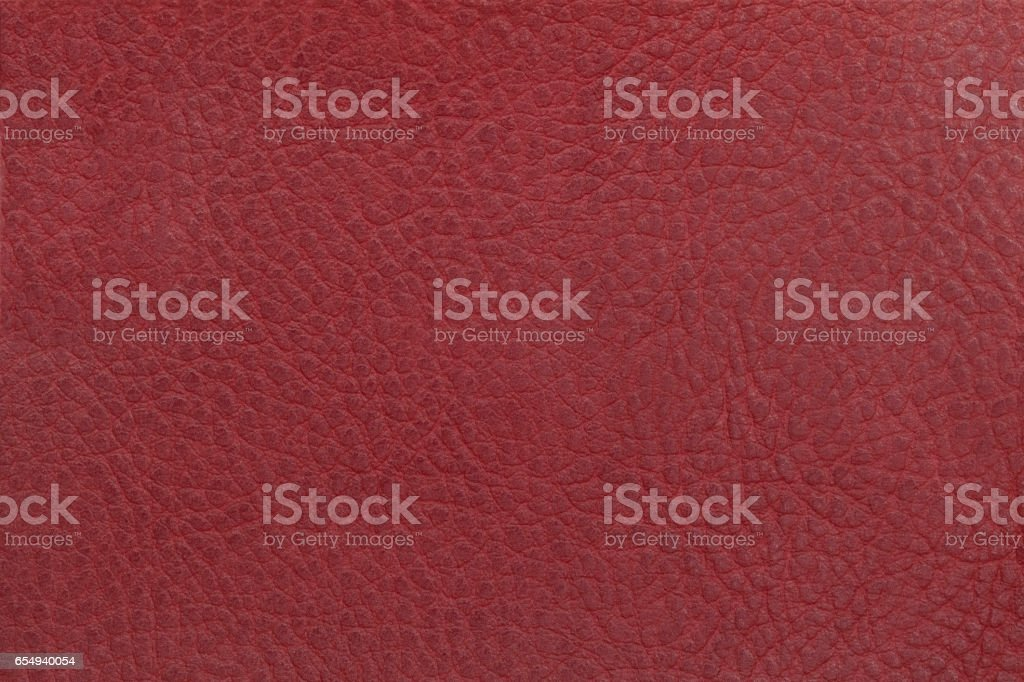 Bright red leather texture background. Closeup photo. stock photo