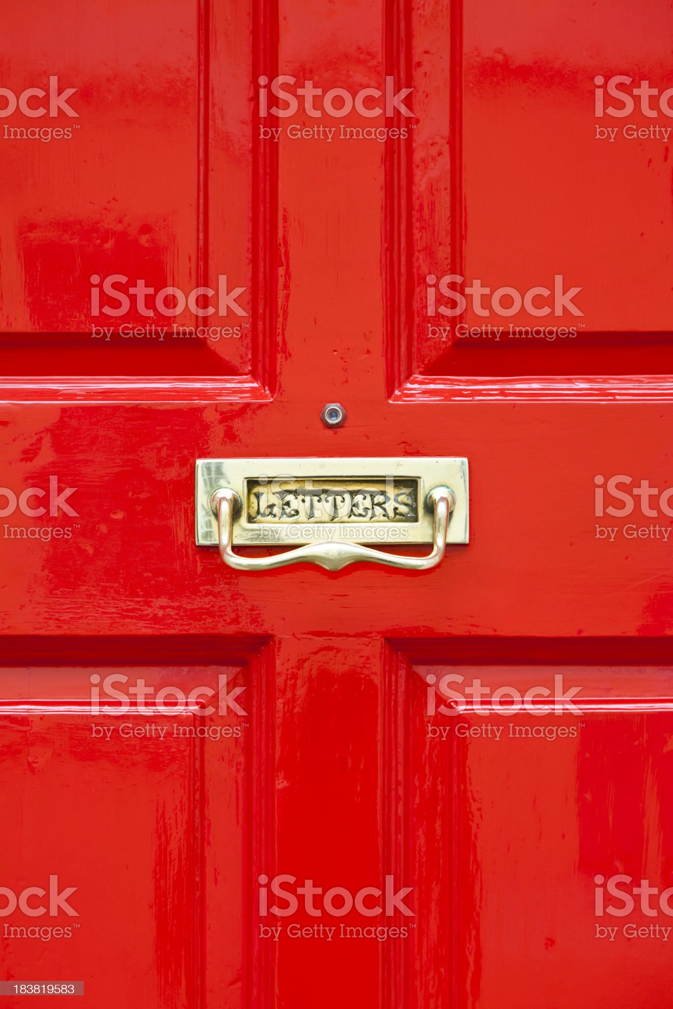 Bright red painted door with brass letterbox royalty-free stock photo
