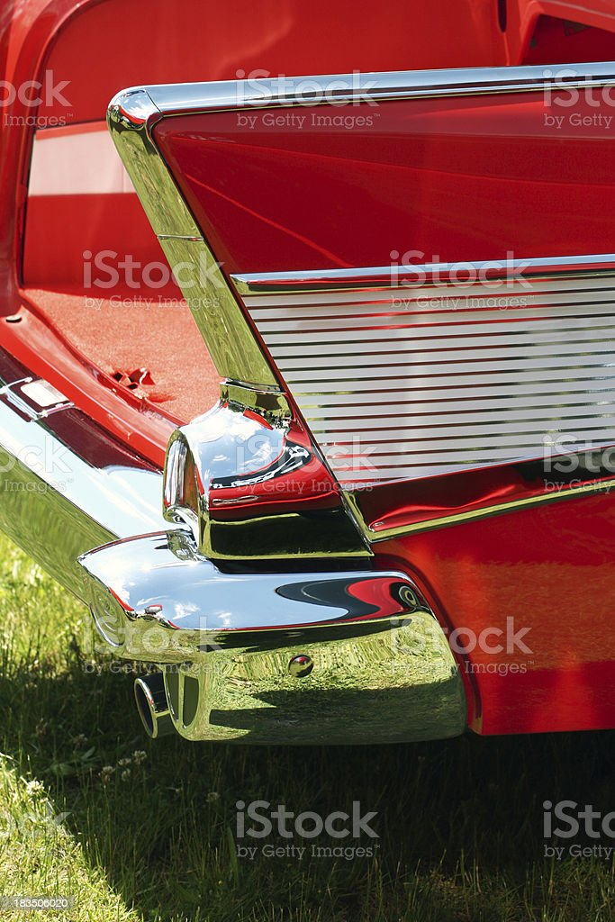Bright red tail fin on 1957 classic car.  Vertical. royalty-free stock photo
