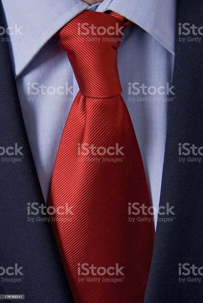 bright red tie on white shirt and black suit royalty-free stock photo