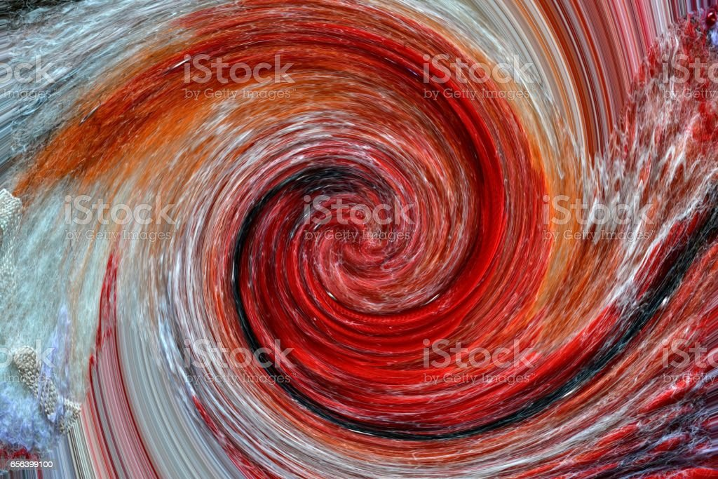 Bright red wool is twisted into an unusual spiral stock photo