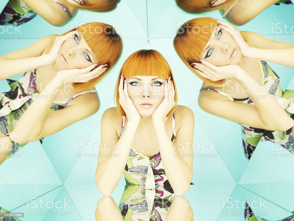 Bright redhead woman in kaleidoscope stock photo