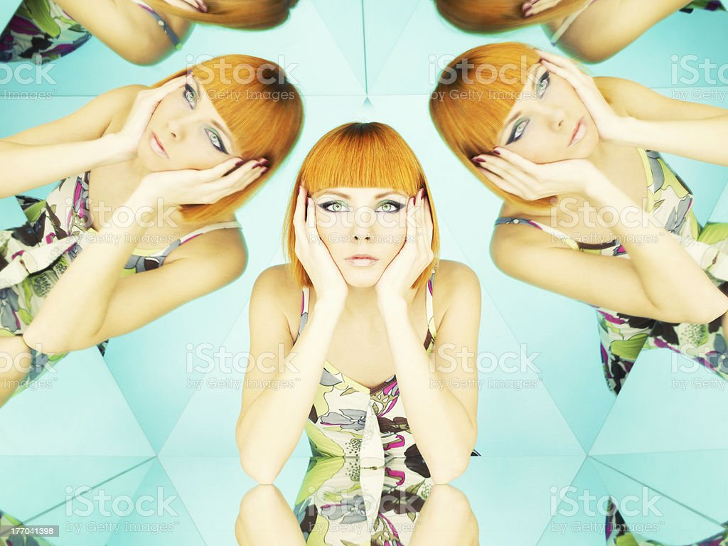 Bright redhead woman in kaleidoscope stock photo