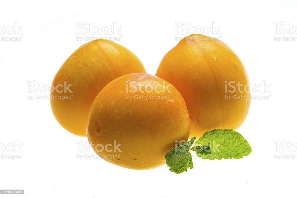 Bright ripe plum with mint royalty-free stock photo