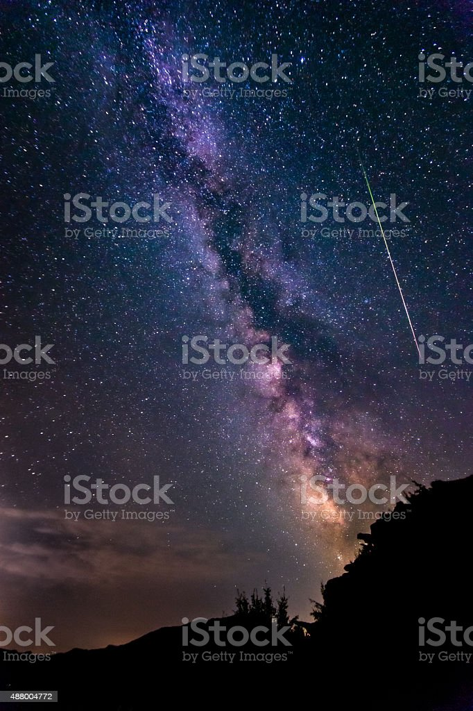 Bright shooting star with Milky Way Galaxy clear starry night stock photo