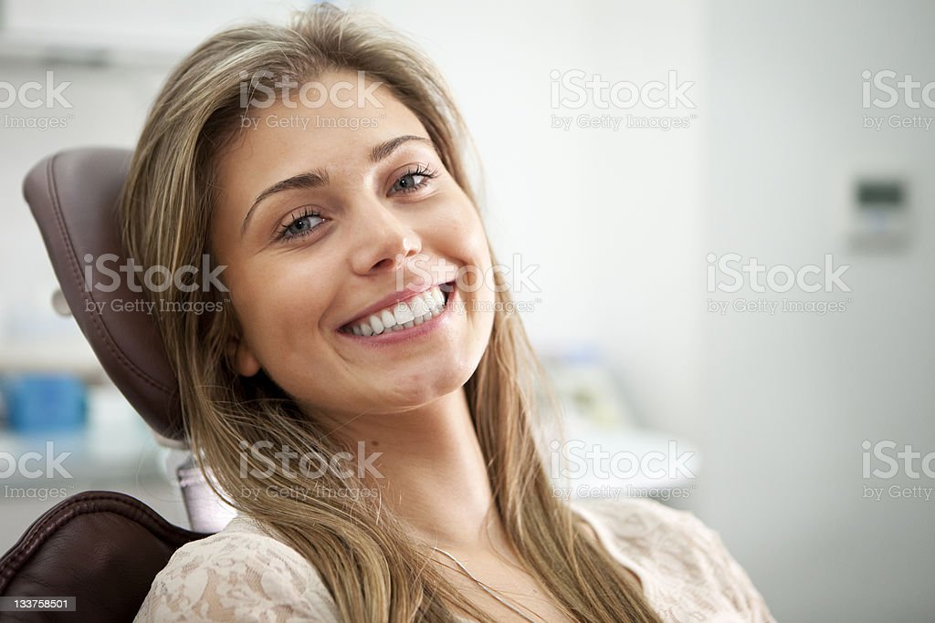 Bright smile from the Dentist's Chair stock photo