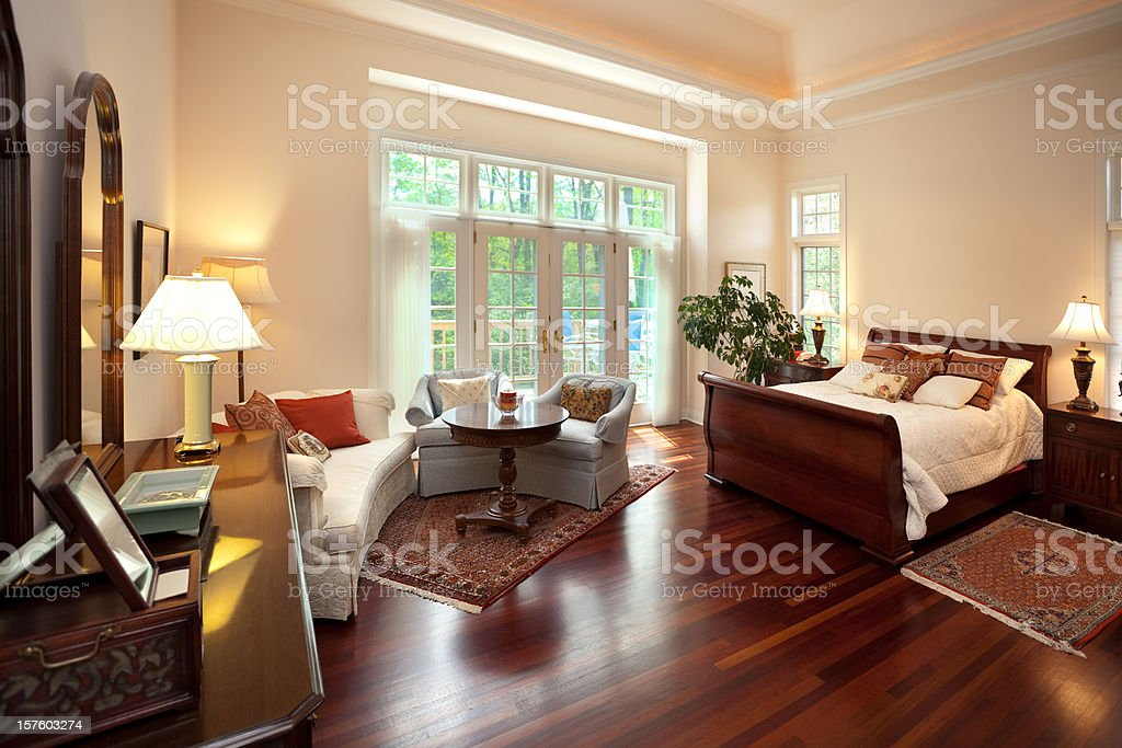 Bright Spacious Master Bedroom Interior Design With Sitting Area royalty-free stock photo