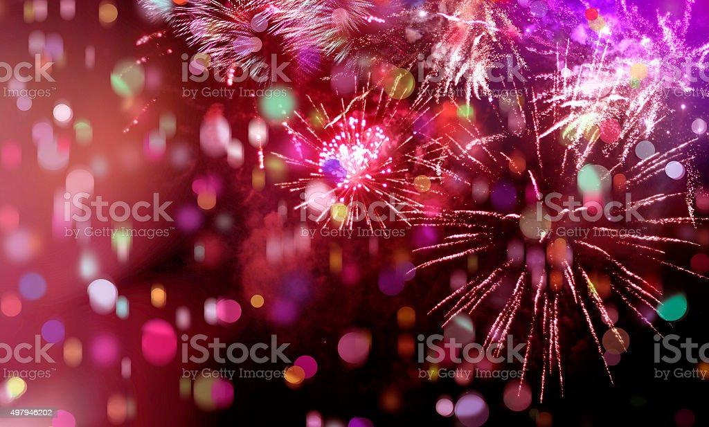 bright sparkling multicolor fireworks and confetti stock photo